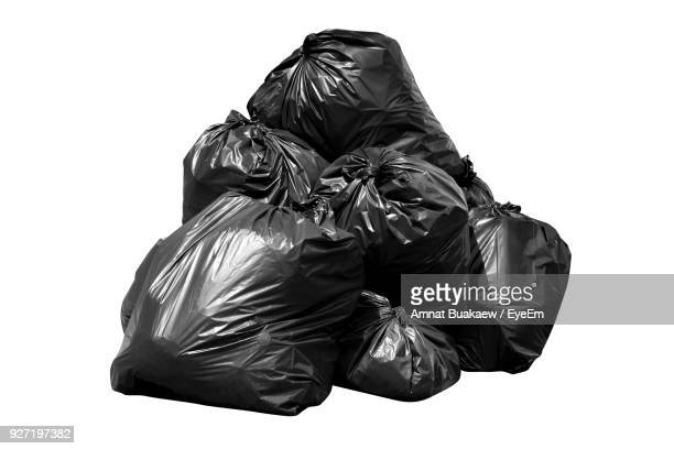 rear view of garbage bag against white background - garbage stock pictures, royalty-free photos & images