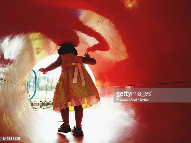 Rear View Of Girl In Tunnel At Playground