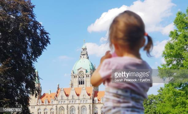 rear view of girl looking at church - hanover germany stock pictures, royalty-free photos & images