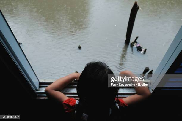 Rear View Of Girl Looking At Water