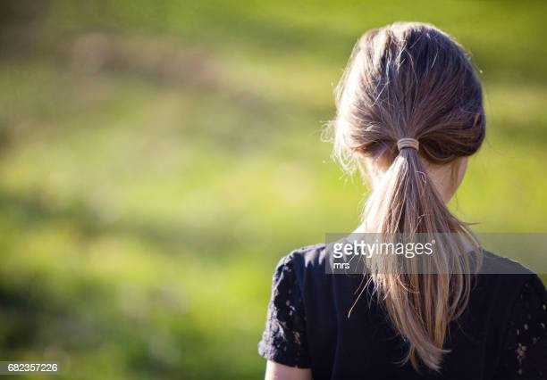 rear view of girl outdoors - ponytail stock pictures, royalty-free photos & images