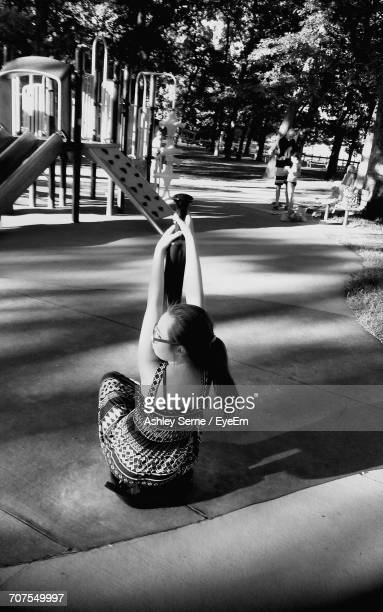 Rear View Of Girl Playing At Park