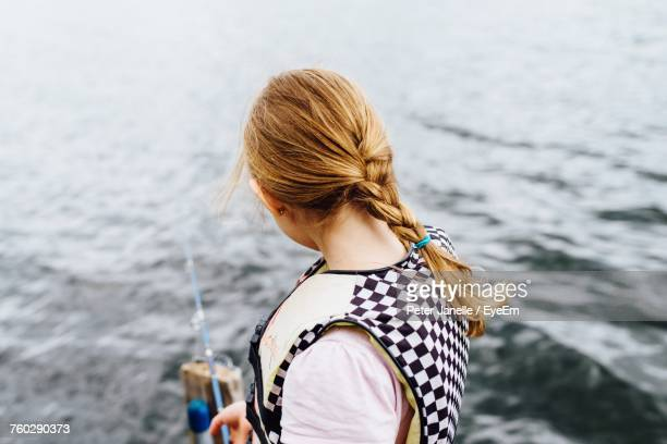 Rear View Of Girl Standing Against Sea