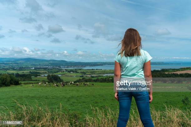 rear view of girl standing by plants against sky - county waterford ireland stock pictures, royalty-free photos & images