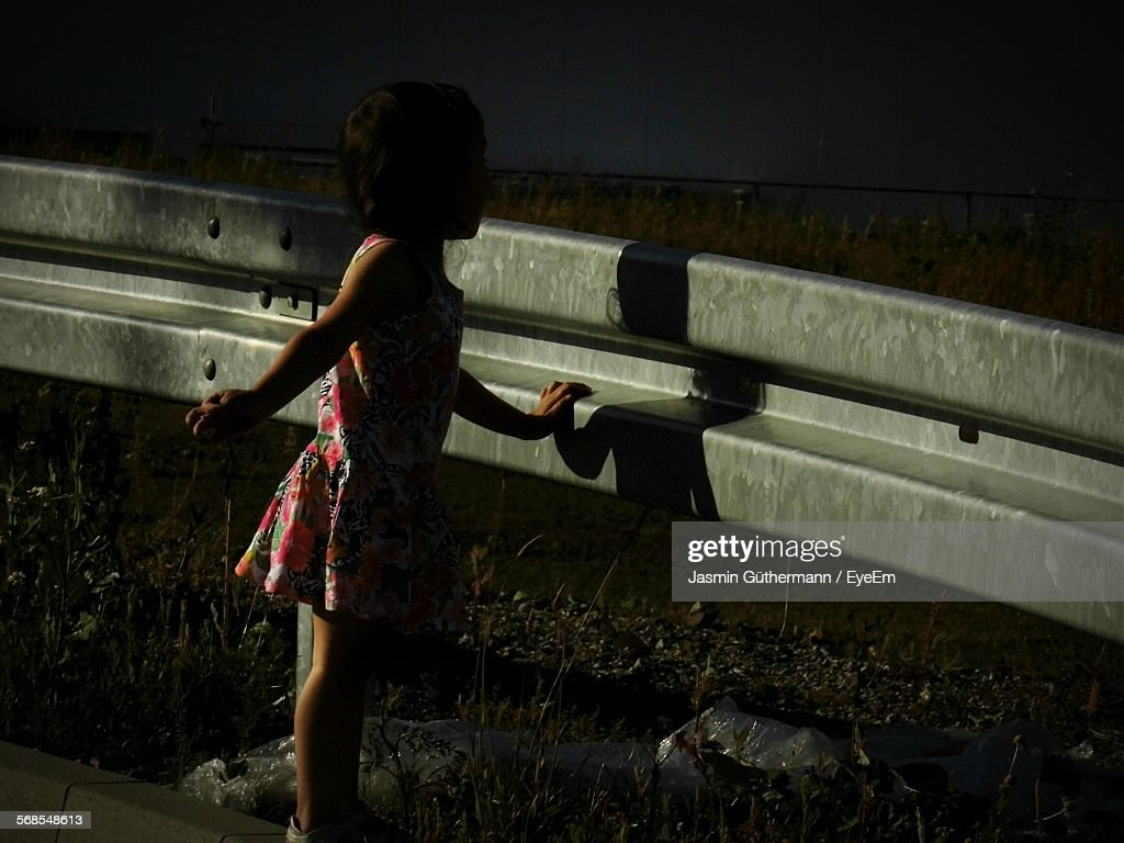 Rear View Of Girl Standing On Field : Stock Photo