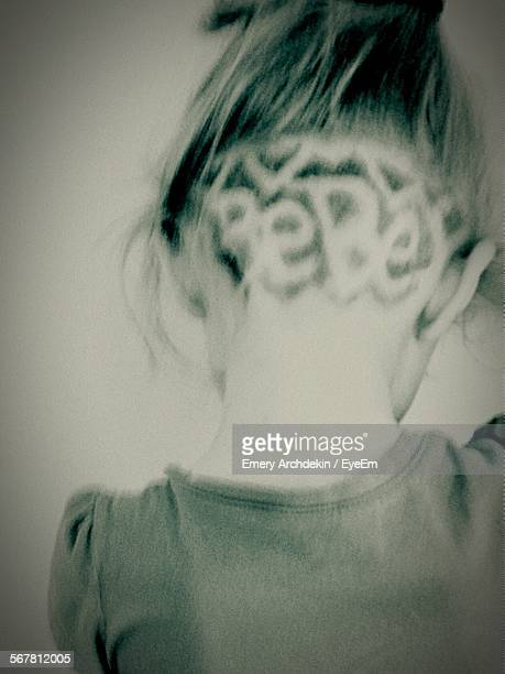 rear view of girl with fashionable hairstyle - emery stock photos and pictures