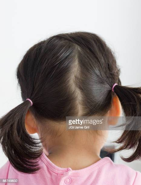 Rear view of girl with pigtails