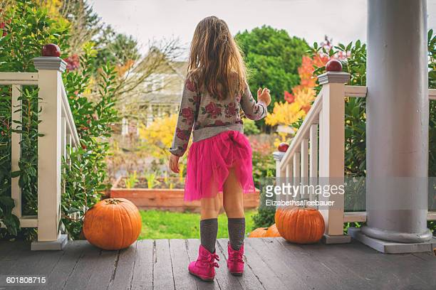 rear view of girl with skirt tucked into her underwear - little girls up skirt stock photos and pictures