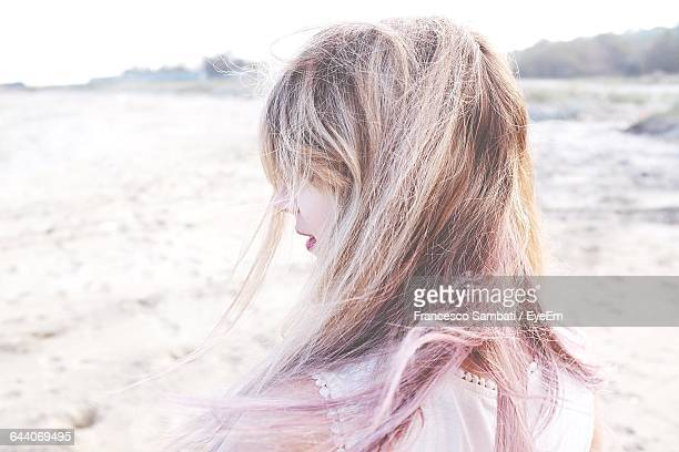 Rear View Of Girl With Tousled Hair At Beach