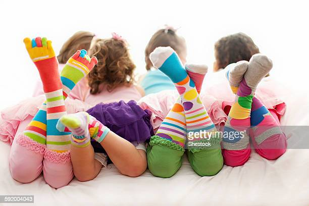 Rear view of girls wearing colorful socks