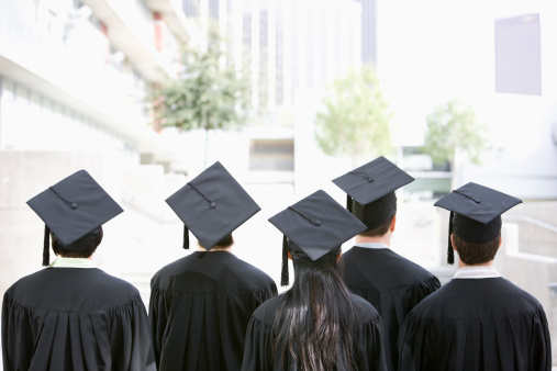 Rear view of graduates in caps and gowns - gettyimageskorea