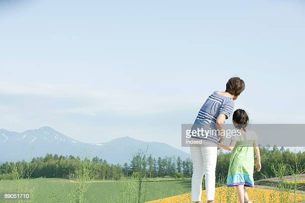 Rear view of grandmother and granddaughter