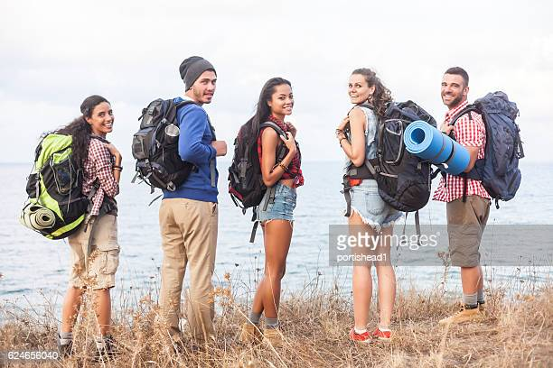 Rear view of group of friends hiking together