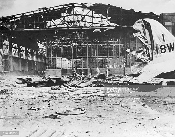 A rear view of hangar number 11 after Japanese bombers dropped their 'eggs' on Hickam Field during the 'sneak' raid on the Hawaiian Island of Oahu...