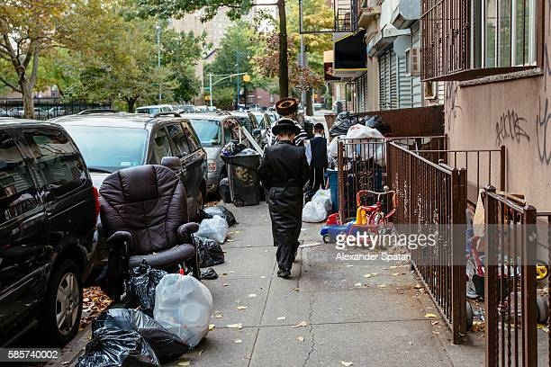 rear view of hasidic jewish family (father and two sons) in traditional clothing walking on the street in williamsburg, new york, usa - jewish people stock pictures, royalty-free photos & images
