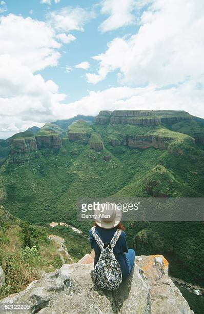 rear view of hiker admiring view. blyde river canyon, mpumalanga province, south africa. - mpumalanga province stock pictures, royalty-free photos & images