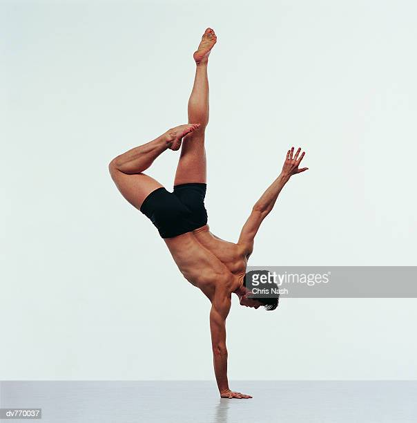 Rear View of Hispanic Male Dancer Doing a Handstand