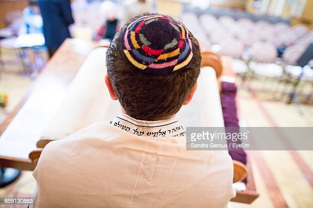 Rear View Of Jewish Boy Reading Talmud