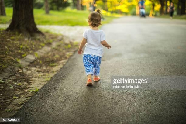 Rear view of little girl walking away