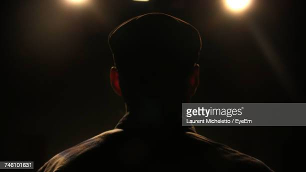 rear view of male actor at illuminated auditorium - actor stock pictures, royalty-free photos & images