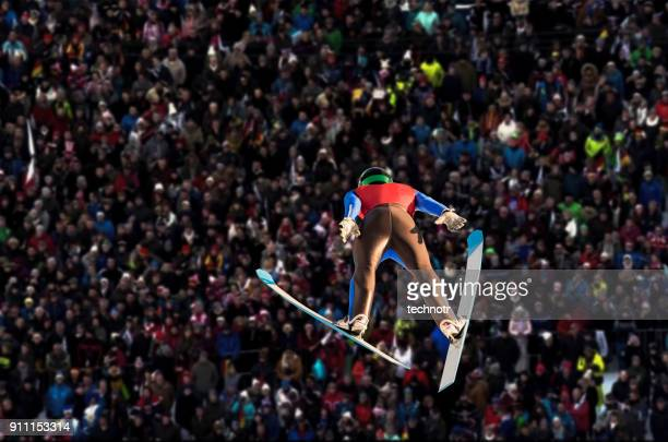 Rear View of Male Ski Jumper in Mid-air