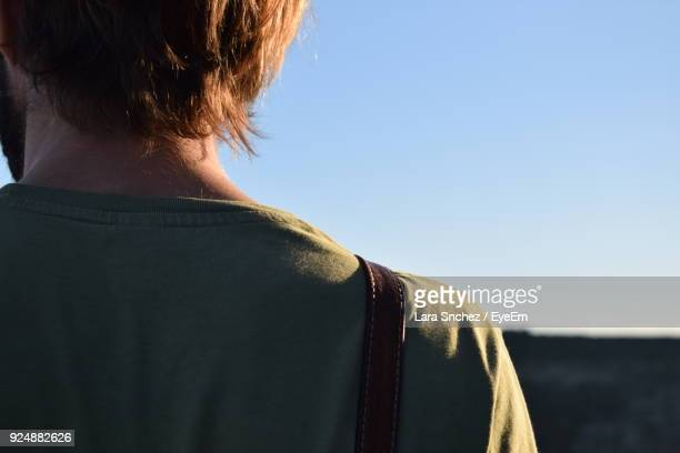 Rear View Of Man Against Clear Sky