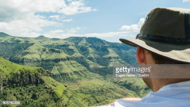 rear view of man against mountains against sky - durban stock pictures, royalty-free photos & images