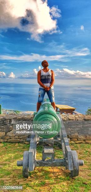 rear view of man against sky, amazing view - port of spain stock pictures, royalty-free photos & images