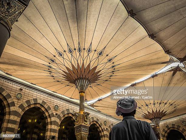 rear view of man at al-masjid an-nabawi mosque - al madinah stock pictures, royalty-free photos & images