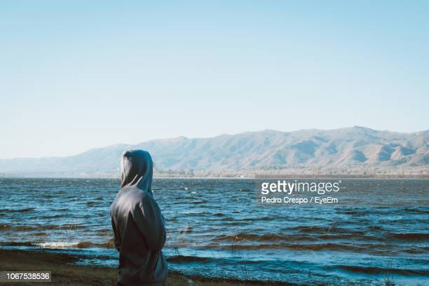 rear view of man at beach against clear sky - cordoba argentina stock photos and pictures