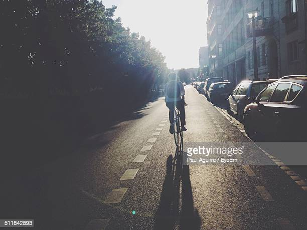Rear view of man cycling in city