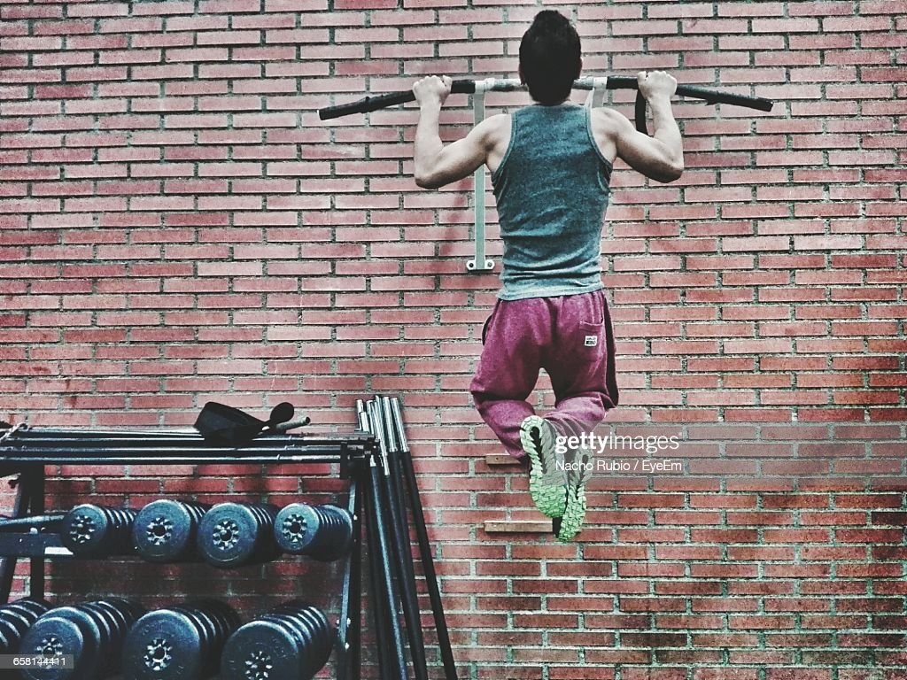 Rear View Of Man Exercising In Gym : Stock Photo