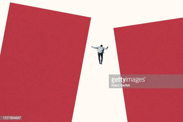 rear view of man falling between red bar graphs - graphic accident photos stock pictures, royalty-free photos & images