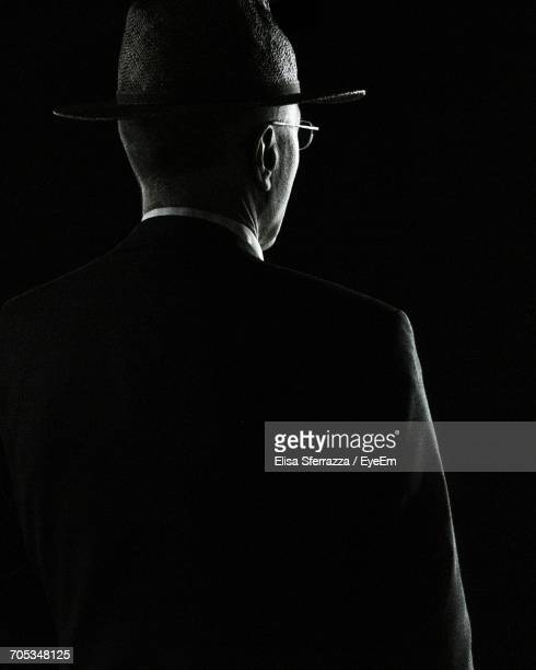 Rear View Of Man In Black Background