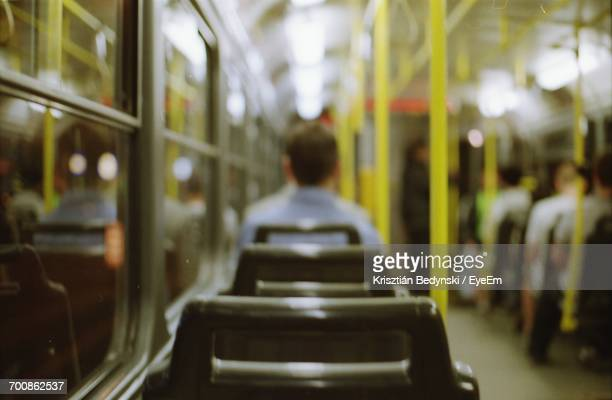 Rear View Of Man In Bus