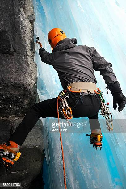 Rear view of man in cave ice climbing, Saas Fee, Switzerland