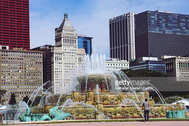 Rear View Of Man Looking At Buckingham Fountain In Grant Park