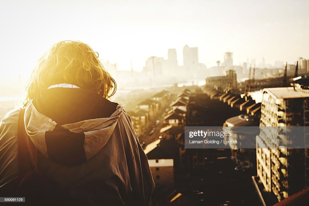 Rear View Of Man Looking At Cityscape : Stock Photo