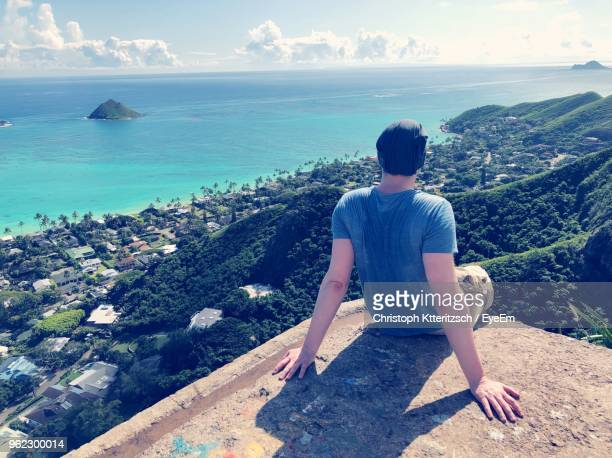 rear view of man looking at sea against sky - kailua stock pictures, royalty-free photos & images