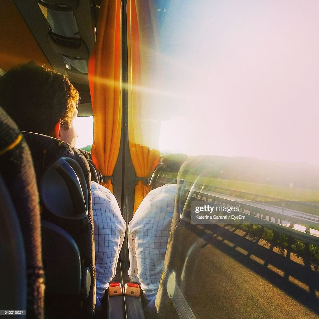 Rear View Of Man Looking Through Bus Window : Stock Photo