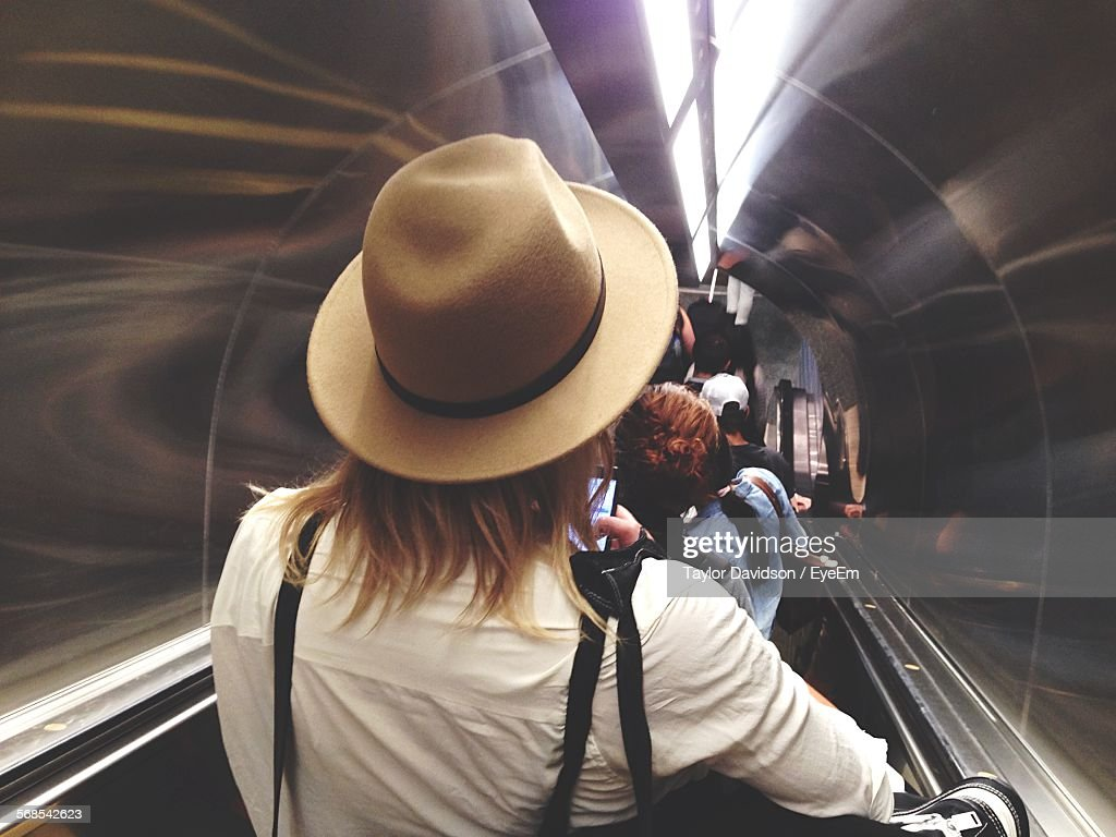 Rear View Of Man On Escalator In Subway : Stock Photo