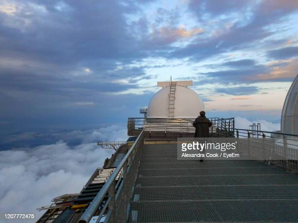rear view of man on railing and observatory against sky - bagneres de bigorre stock pictures, royalty-free photos & images