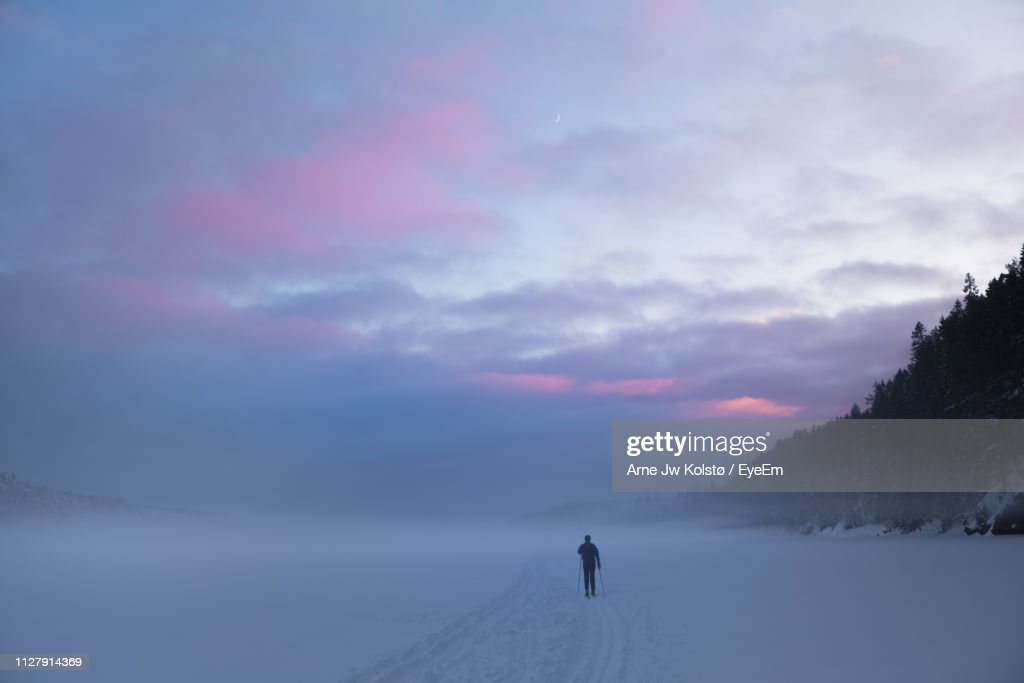 Rear View Of Man On Snow During Sunset : Stock Photo
