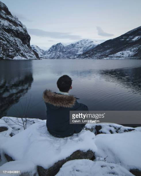 rear view of man on snowcapped mountains during winter - hordaland county stock pictures, royalty-free photos & images