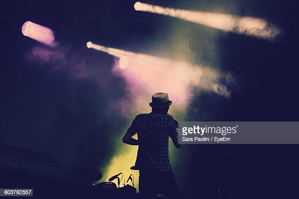 rear view of man singing in music concert - singer stock pictures, royalty-free photos & images