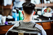 rear view man sitting barbers chair