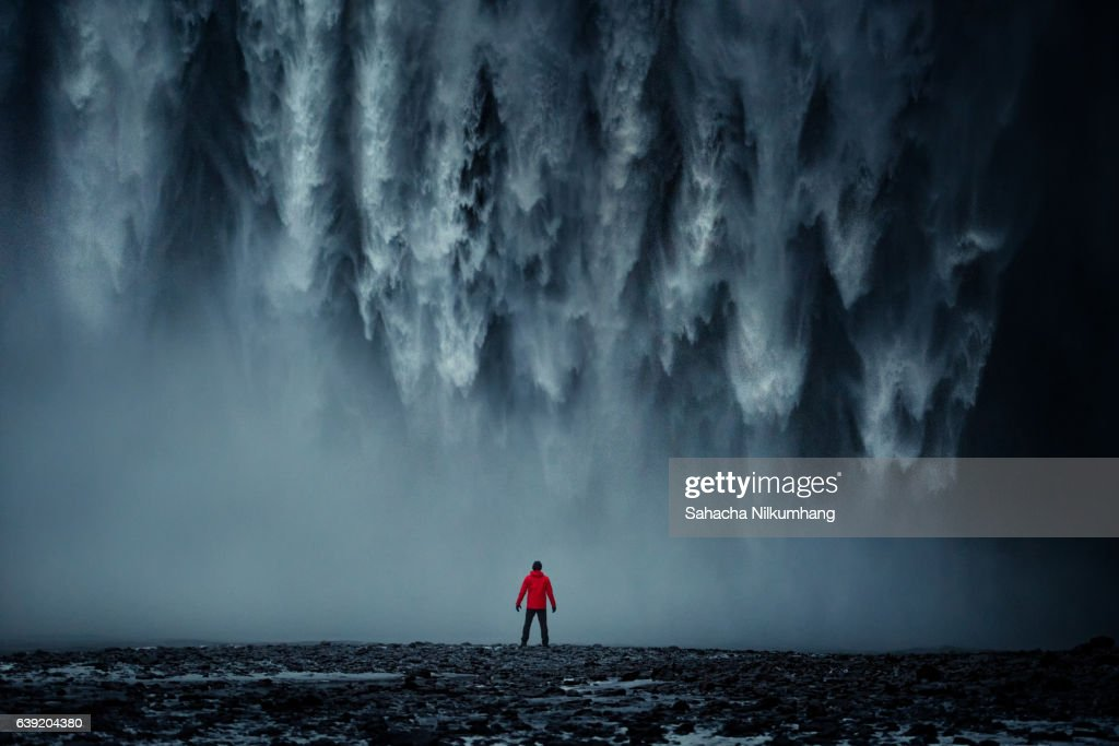 Rear View Of Man Standing Against Skogafoss : Stock Photo