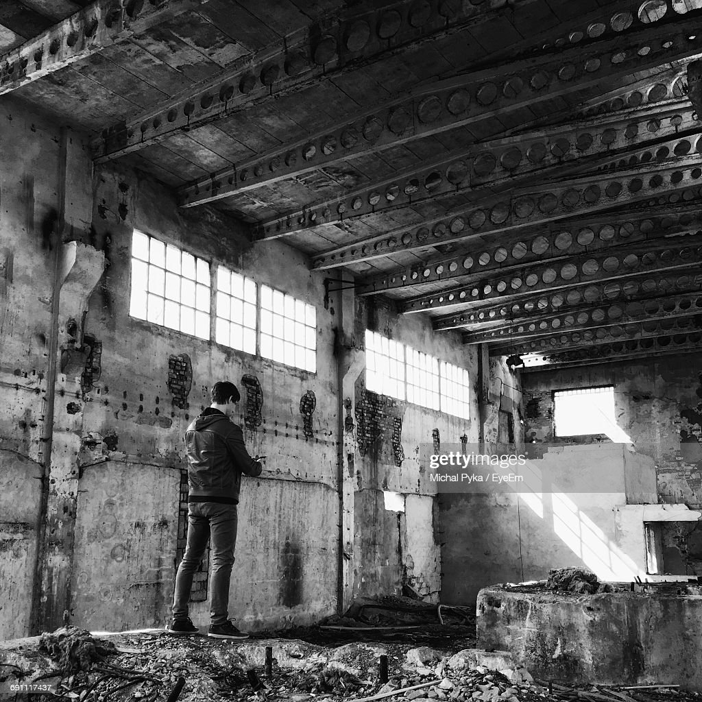 Rear View Of Man Standing In Abandoned Building High Res Stock Photo Getty Images