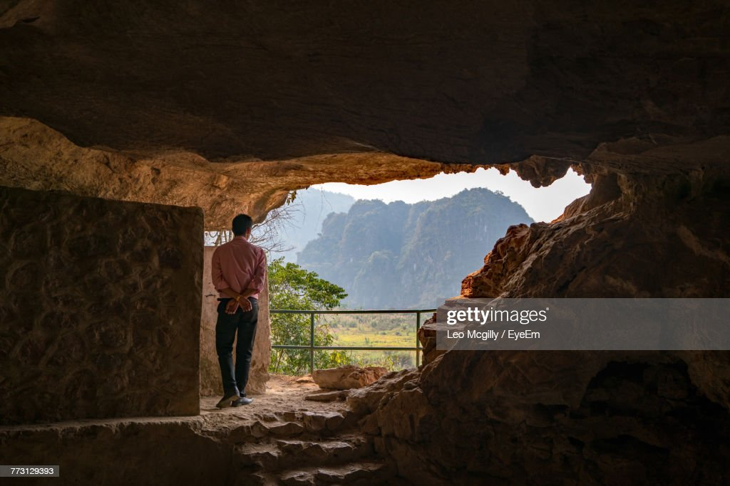 Rear View Of Man Standing In Cave : Photo