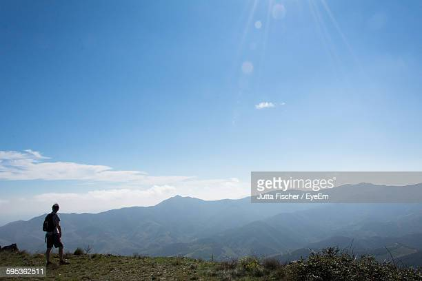 rear view of man standing on countryside landscape  - collioure photos et images de collection